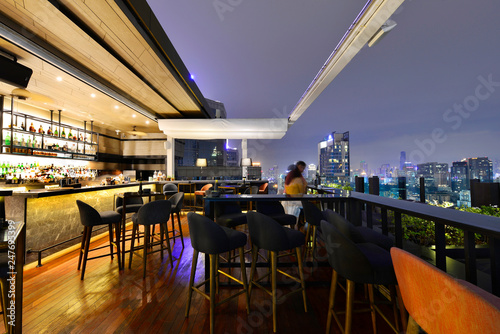 Fotografie, Obraz Bangkok city view point from rooftop bar, overlooking a magnificent cityscape bl