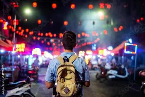 Fotografie, Tablou Traveler exploring Asian food market street
