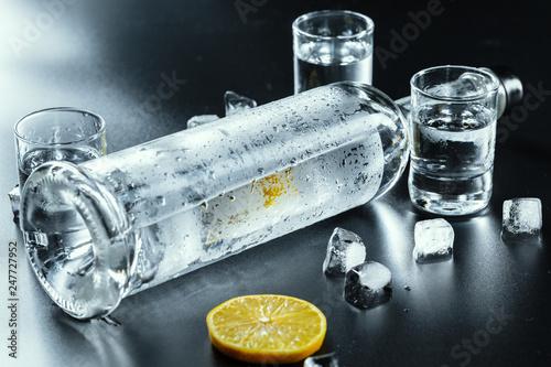 Fotografia Cold vodka in shot glasses on a black background.