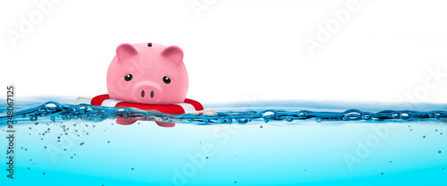 Fotografering Piggy Bank In Life-ring Floating On Water - Financial Security Concept