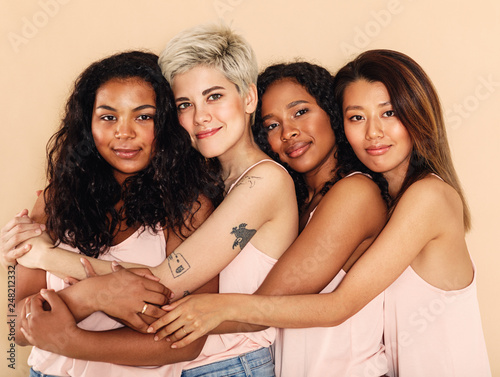 Valokuva Studio shot of a group of beautiful young women hugging each other