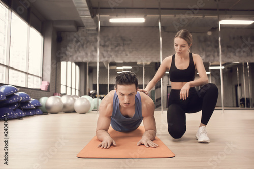 Stampa su Tela Young man training with coach in modern gym