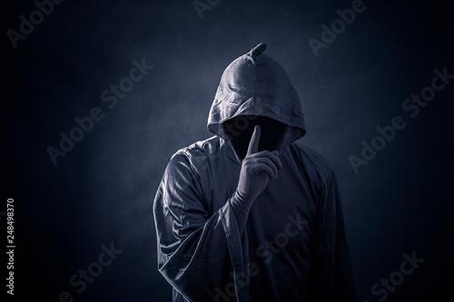 Fototapeta Scary figure in hooded cloak