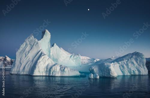 Fotografie, Obraz Close-up iceberg next to the Antarctica shoreline