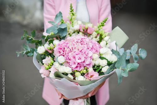 Slika na platnu Woman holding bouquet of beautiful flowers in hands