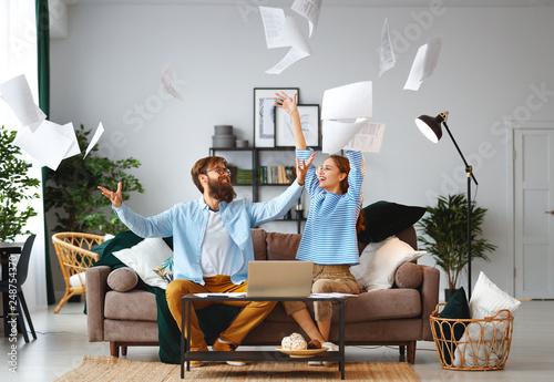 Billede på lærred married couple with bills receipts documents and laptop at home.