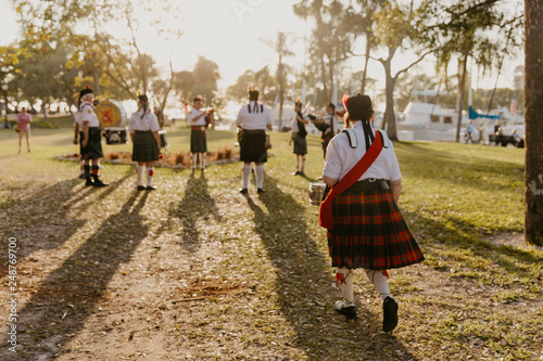 Fotografija Irish Group of Bagpipe and Drummer Musicians Wearing Authentic European Kilts Wh