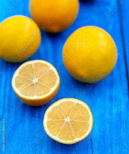 lemons on blue wooden background