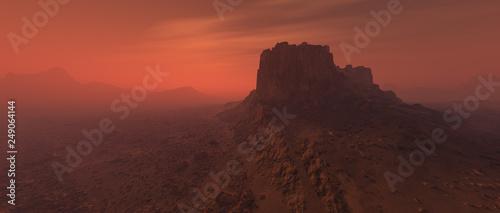 Fotografia Bare rough rocky mars terrain in fog.