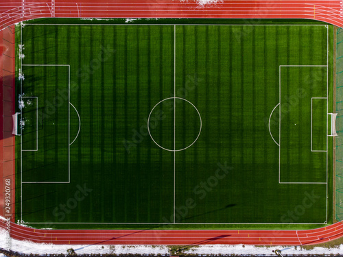 Leinwand Poster Aerial view of soccer field. Aerial shot of football stadium.