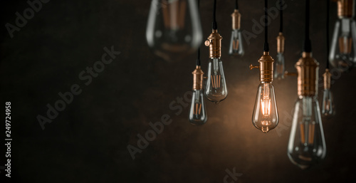 Fotografia, Obraz Individuality concept, one bright light bulb standing out from the crowd with co