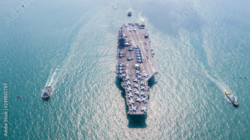 Photo United States of America warship navy nuclear aircraft carrier, American military battleship navy ship carrier airplane full loading plane fighter jet aircraft, USA, Aerial view in open ocean
