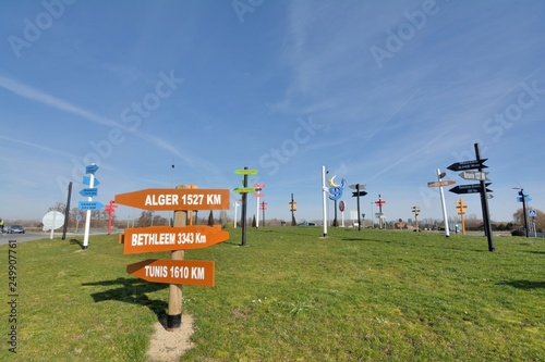 Direction signs in wood showing the distance of the main towns of the world Fototapeta