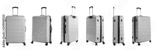 Fotografia Set of stylish light suitcase for travelling on white background