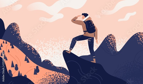 Fotografia Man with backpack, traveller or explorer standing on top of mountain or cliff and looking on valley