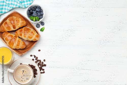 Coffee, juice and croissants breakfast Fototapet