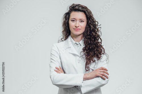 Wallpaper Mural Portrait of happy young smiling girl doctor