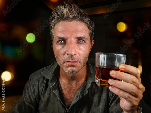 messy and wasted man drunk at night club or bar drinking whiskey glass looking h Fototapet