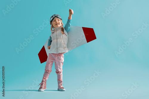 Stampa su Tela girl in an astronaut costume