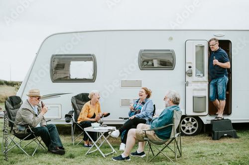Slika na platnu Group of senior people gathering outside a trailer