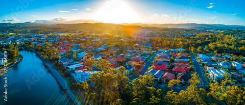 Canvas Print Sunset over luxury homes at Varsity Lakes suburb on the Gold Coast in Australia