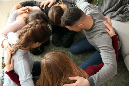 Fototapeta Group of people praying together indoors