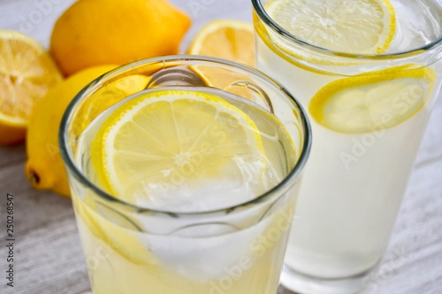 Fototapeta Two glasses of lemonade on a wooden surface