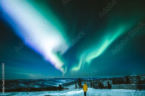Canvas Print Girl watching Aurora borealis in Fairbanks, Alaska