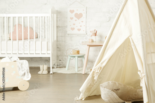 Fotografia Tent, crib and kids furniture in the nursery room, nicely decorated kids room