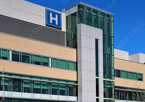 Fotografía Modern style building with large H sign for hospital