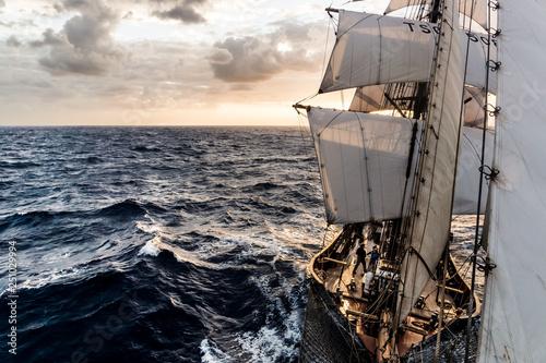 Fotomural Ship sailing on the Atlantic Ocean at sunrise