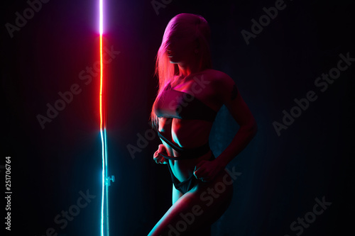 Pole dance girl with perfect body in black sexy lingerie. Night club concept