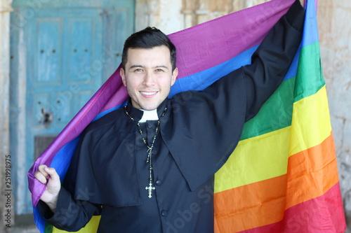 Canvas Print Priest holding the rainbow flag