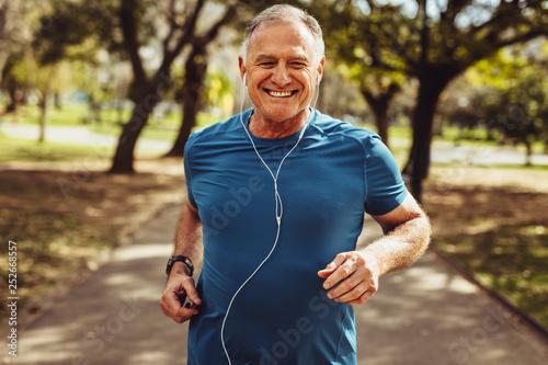 Wallpaper Mural Senior man jogging