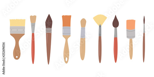 Obraz na plátně Drawing tools, set paint brushes in row on white isolated background