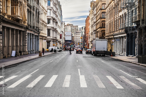 Fotografija New York City asphalt road on busy intersection streets with car traffic at dayt