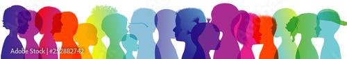 Silhouette group of modern children in rainbow colored profile. Communication between multi-ethnic children. Children talking. Multiple exposure