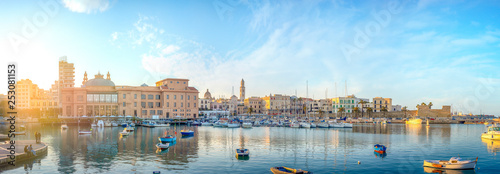 Fotografiet Bari, Puglia, Italy - Panoramic view of waterfront and harbor with boats - Margherita theater, cathedral and fort of Sant'Antonio