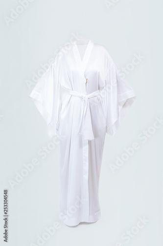 Wallpaper Mural Silk female long white robe isolated on grey