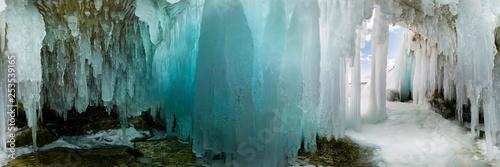 Obraz na plátne Blue Ice cave grotto on Olkhon Island, Lake Baikal, covered with icicles