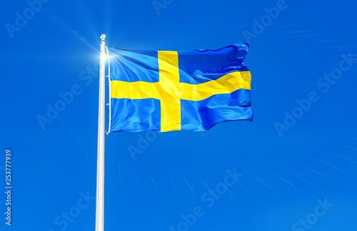 Wallpaper Mural Flag of Sweden flying in the wind against the sky