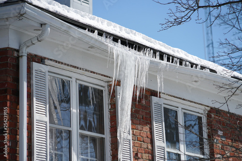 Wallpaper Mural icicle on the house roof in winter season