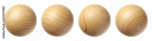 Photo Set of wooden spheres isolated on a white background