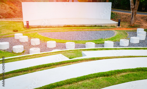 Photo Stage outdoors / stage show with Park bench Cement and pathway in the garden