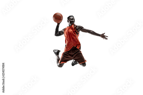 Fototapeta Full length portrait of a basketball player with a ball isolated on white studio background