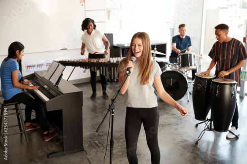 Stampa su Tela Students At Performing Arts School Playing In Band At Rehearsal