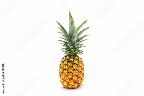 Fotografia Pineapple with green leaves isolated on white background.