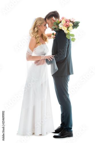 Obraz na plátne beautiful bride in white wedding dress, and groom in elegant black suit standing