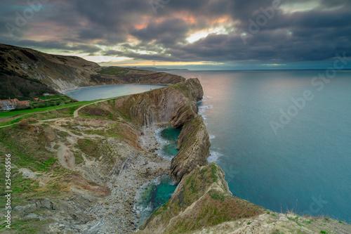 Carta da parati Winter sunrise over the Stairhole and Lulworth Cove, Dorset, UK