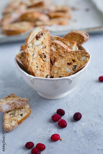 Fotografija Traditional Italian cranberry almond biscotti biscuits in a bowl